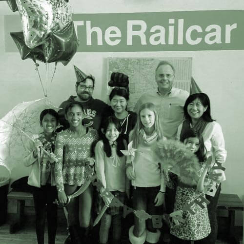 Family Posing For Picture At The Railcar Escape Room